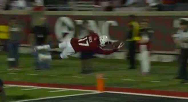 James Quick dives into the end zone for a touchdown during Louisville's 45-3 win over Samford.
