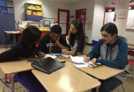 Jennifer Powell, a teacher at Waggener High School, works with students after class on Wednesday (By Toni Konz, WDRB News)