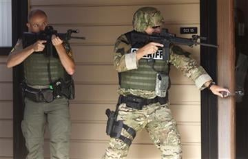(Michael Sullivan /The News-Review via AP). Authorities respond to a report of a shooting at Umpqua Community College in Roseburg, Ore., Thursday, Oct. 1, 2015.