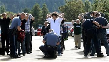 (Mike Sullivan/Roseburg News-Review via AP). Police search students outside Umpqua Community College in Roseburg, Ore., Thursday, Oct. 1, 2015, following a deadly shooting at the college.