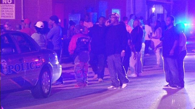A crowd of people gathered outside Club Cedar after a man was fatally shot on Oct. 6.