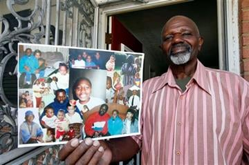 (AP Photo/Alex Brandon). In this Sept. 16, 2015, photo, Kenneth Evans holds a composite of photographs of his son Tuan Evans, as he poses for a photograph at his home in Temple Hills, Md.