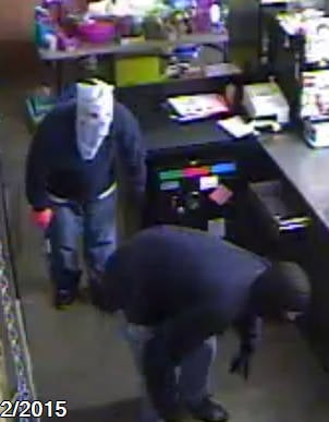 Surveillance images provided by the sheriff's office show two men in masks and gloves.