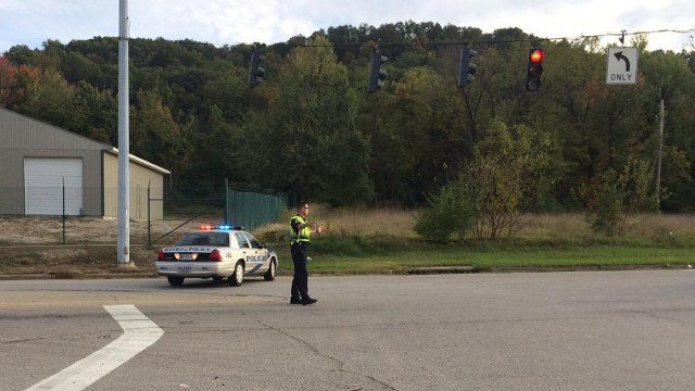 Metro police officer directs traffic at Minor Lane and South Park Road during death investigation Oct. 13.
