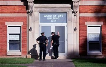 (AP Photo/Mike Groll). Police knock on the door of the Word of Life church while serving paperwork on a church member, Thursday, Oct. 15, 2015, in New Hartford, N.Y.