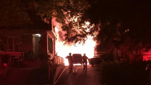 Flames shoot out of a building on Beechwood Avenue in the Highlands early on Oct. 15.
