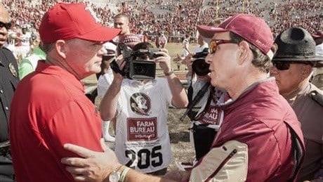 Bobby Petrino and Florida State coach Jimbo Fisher shake hands after Saturday's 41-21 FSU victory. (AP photo)