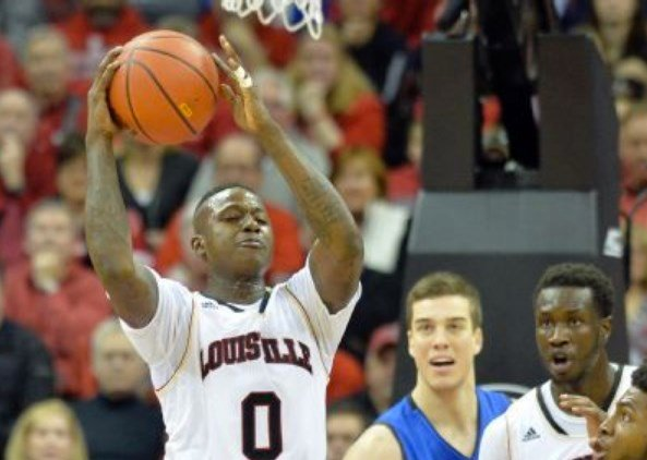 Former U of L guard Terry Rozier (0) has been reluctant to defend the program from the allegations in a controversial book.
