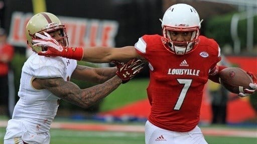 Reggie Bonnafon looks to break away from a defender during Louisville's win Saturday. (AP photo)