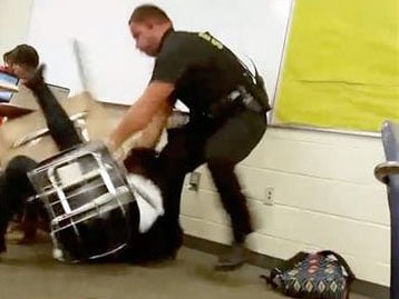 (AP Photo). In this Monday, Oct, 26, 2015 photo made from video taken by a Spring Valley High School student, Senior Deputy Ben Fields tries to forcibly remove a student who refused to leave her high school math class, in Columbia S.C.