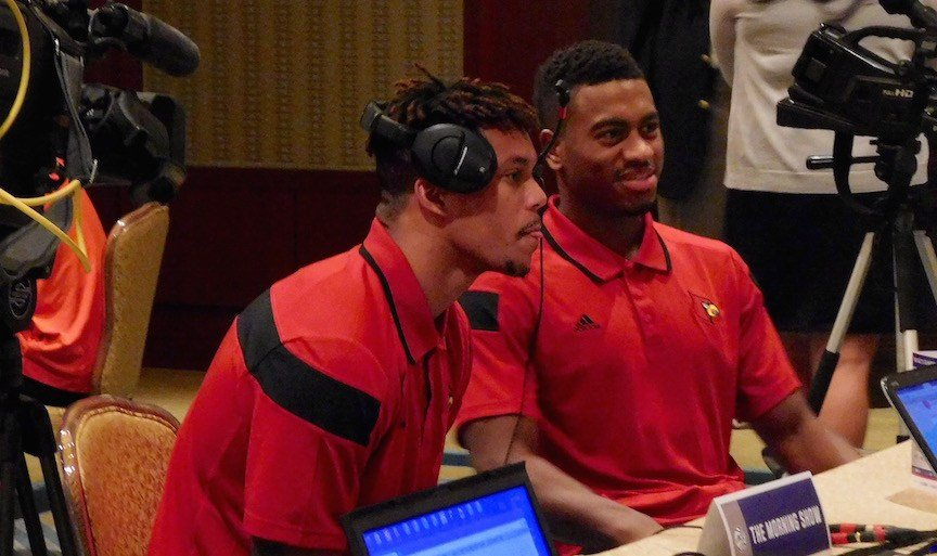 Damion Lee and Trey Lewis of Louisville wait for a radio interview at ACC Media Day. (WDRB photo by Eric Crawford)