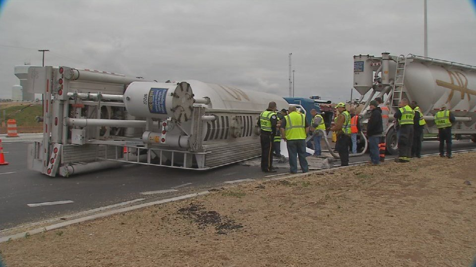 It took several hours for crews to offload a semi that overturned on Hwy. 62 at the 265 roundabout in Jeffersonville on Oct. 30, 2015.