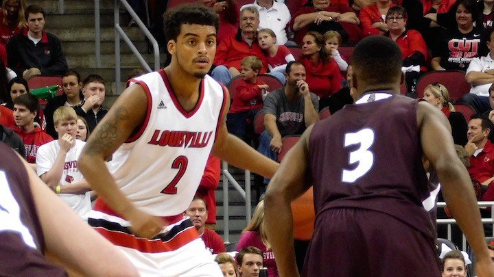 Louisville's Quentin Snider works against Bellarmine point guard Al Davis in Sunday's win. (WDRB photo by Eric Crawford)