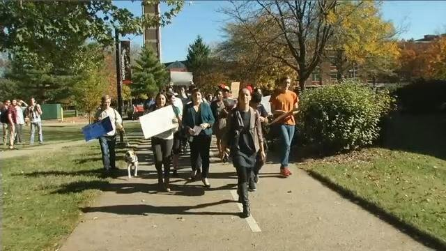 U of L students and staff marched to Dr. James Ramsey's office on U of L's campus on Nov. 3, 2015, to protest a photo some are calling racist.
