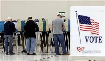(AP Photo/Tony Dejak). Voters cast their vote at the athletic wing of Orange High School Tuesday, Nov. 3, 2015, in Moreland Hills, Ohio.