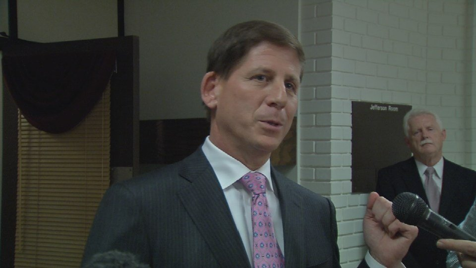 University of Louisville Board of Trustees chairman Dr. Larry Benz speaks to the media after a board meeting Thursday, Nov. 5, 2015.