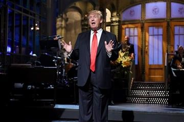 """(Dana Edelson/NBC via AP). Republican presidential candidate Donald Trump speaks as guest host during the monologue on """"Saturday Night Live"""", Saturday, Nov. 7, 2015."""