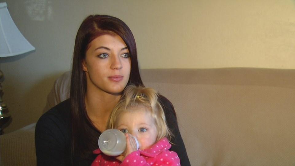 Steven Hesler's fiancee, Megan Davis, with their daughter, Sophia.