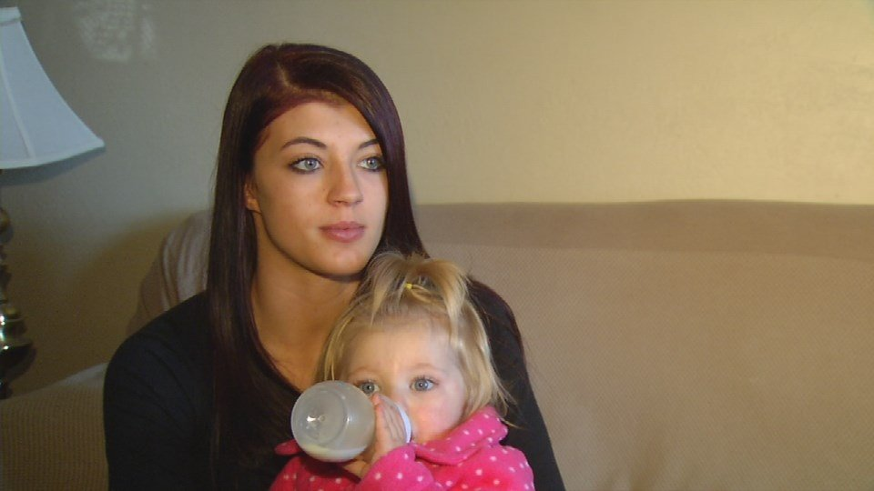 Steven Hesler's fiancee, Megan Davis, with their daughter, Sophia.