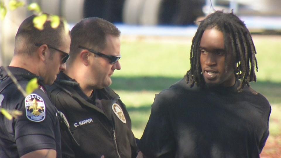 Police taking the suspect into custody.