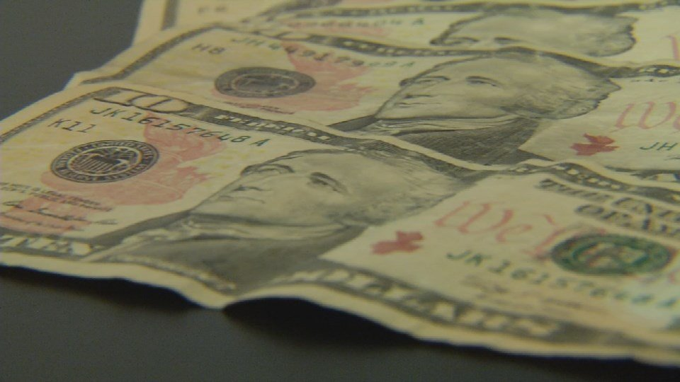 Police say real $10 bills will make dark marks on white paper, because the ink never fully dries.