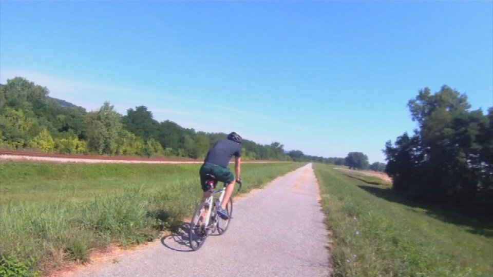 A bicyclist uses a section of the Louisville Loop