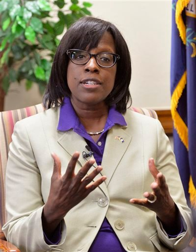 Kentucky Lieutenant Gov.-elect, Republican Jenean Hampton, the first African-American person to hold a statewide office, talks about her plans once she takes office at the Kentucky state Capitol in Frankfort, Ky. (AP Photo/Timothy D. Easley)