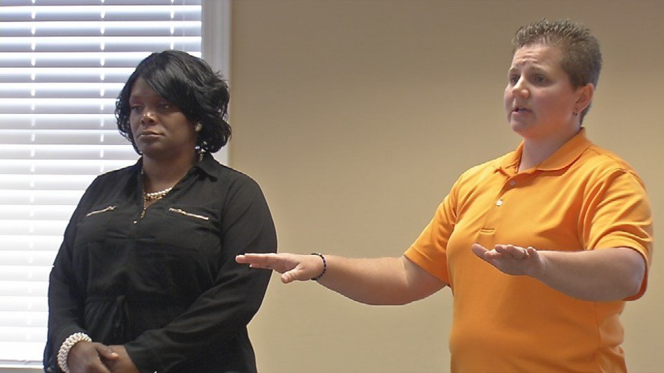 Renfro and Anderson educate foster care staff about human trafficking.