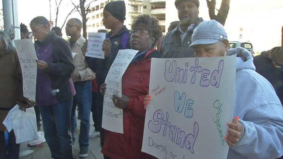 Dozens rallied Friday in support of a local judge who prosecutors are trying to remove from all criminal cases.