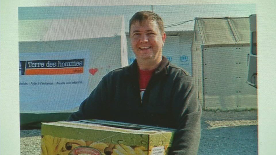 Josh Neal delivering food to refugees near Macedonia