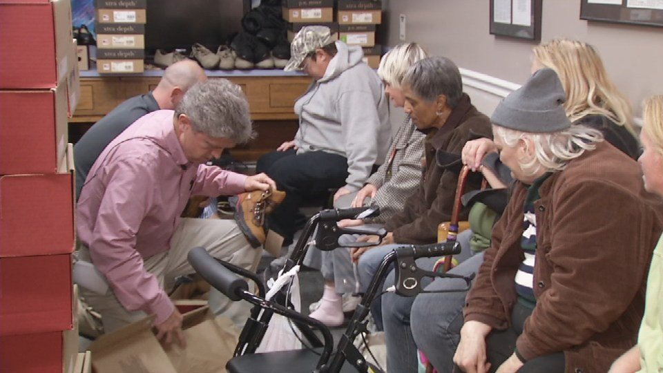 Dr. Quill fits people for shoes at the healing place.
