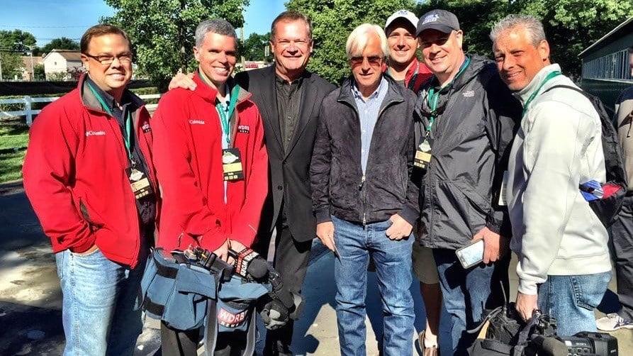 Louisville media at Belmont Park with Triple Crown trainer Bob Baffert.