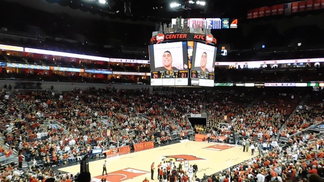 Kyle Kuric spoke to a Louisville basketball crowd at the KFC Yum! Center. (WDRB photo by Eric Crawford)
