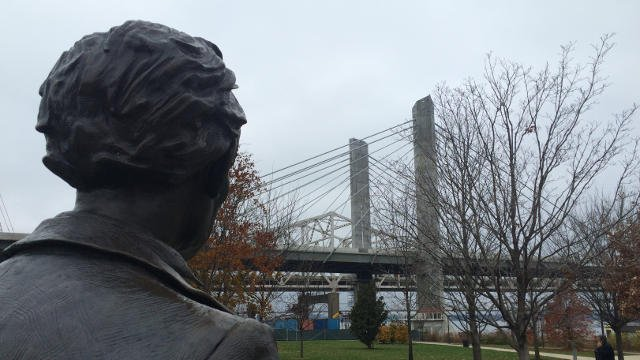 A statue of Abraham Lincoln sits at Waterfront Park with Lincoln himself looking out at the new bridge.