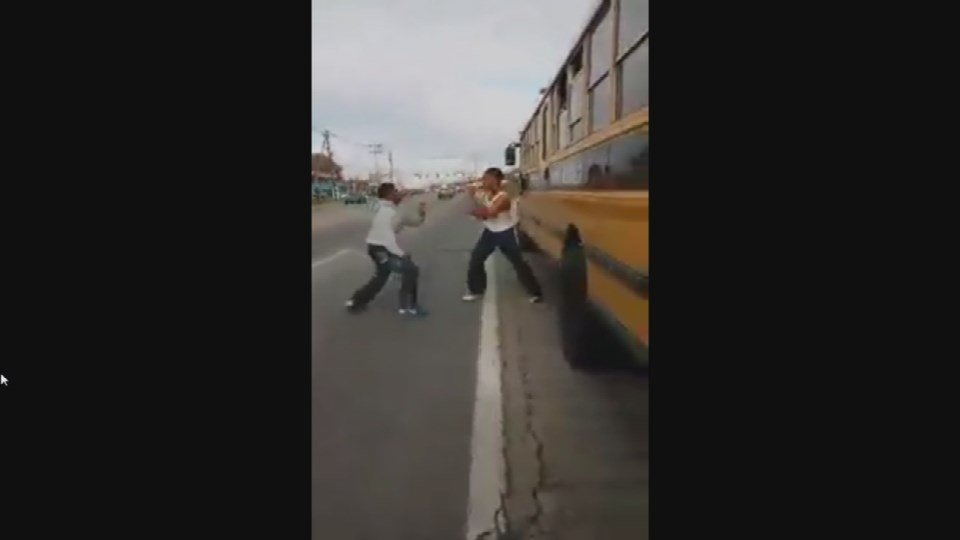 Screen shot of a fight among JCPS students that started on a school bus in November 2013 (WDRB News file photo)