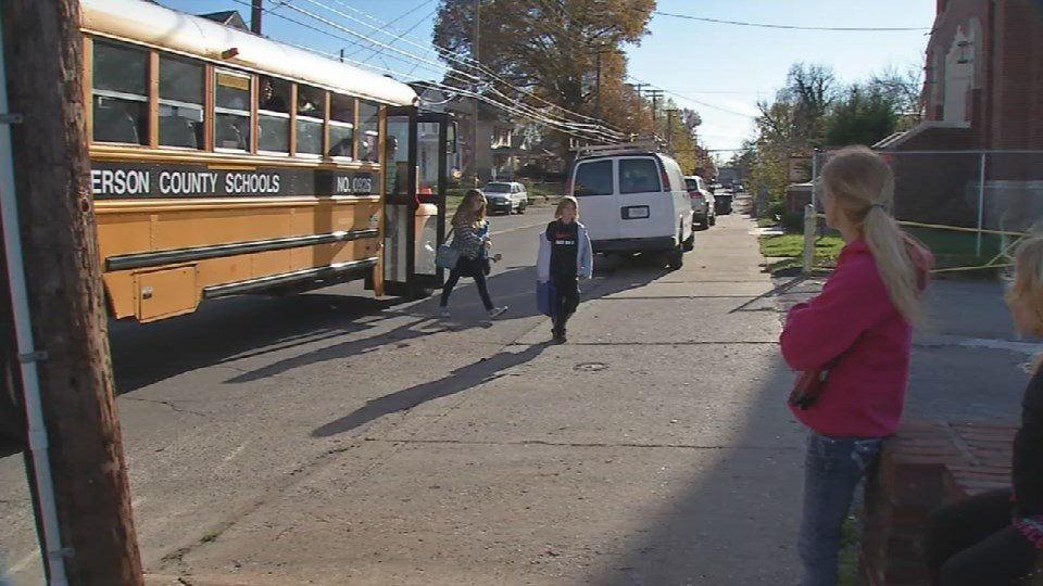Students get off a JCPS school bus in the Portland neighborhood (WDRB News)
