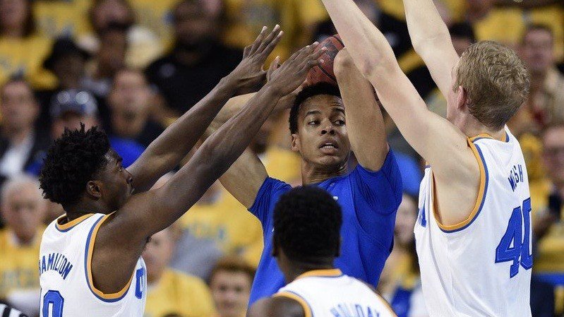 Kentucky forward Skal Labissiere, center, holds the ball as UCLA's Isaac Hamilton, left, Aaron Holiday, front, and Thomas Welsh, right. (AP Photo/Kelvin Kuo)
