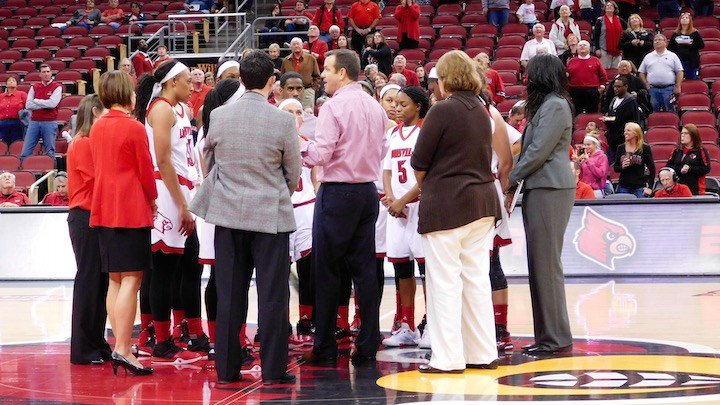 Jeff Walz talks to his team after its season opener. WDRB photo by Eric Crawford.