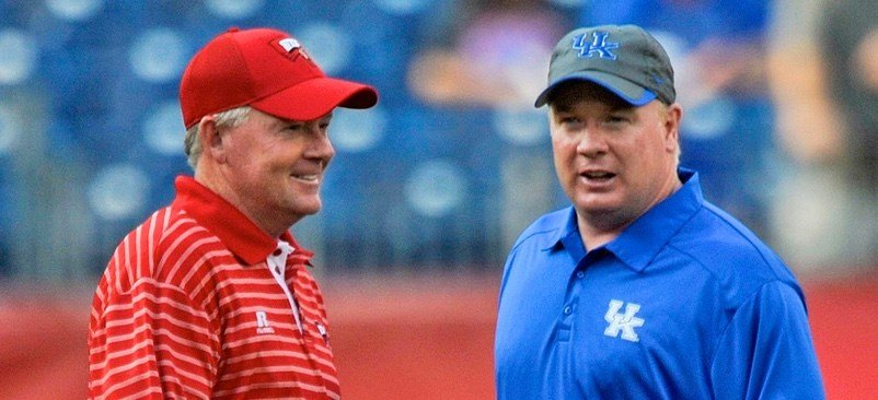 Football attendance at Louisville and Kentucky this season moved in opposite directions.