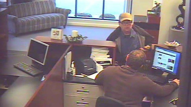 Police say the man shown in this surveillance photo robbed the First Savings Bank in Jeffersonville on Dec. 3, 2015.