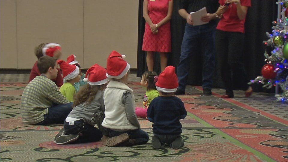 Several children whose parents are deployed attend a Christmas party at the Galt House