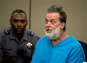 (Andy Cross/The Denver Post via AP, Pool). Robert Lewis Dear talks to Judge Gilbert Martinez during a court appearance on Wednesday, Dec. 9, 2015, in Colorado Springs, Colo.