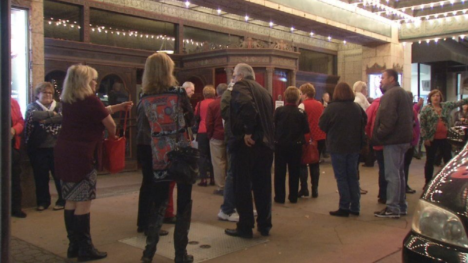 People gather outside the Louisville Palace Theatre