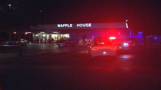 Police look for clues after an early morning shooting at the Waffle House in New Albany on Dec. 12, 2015.
