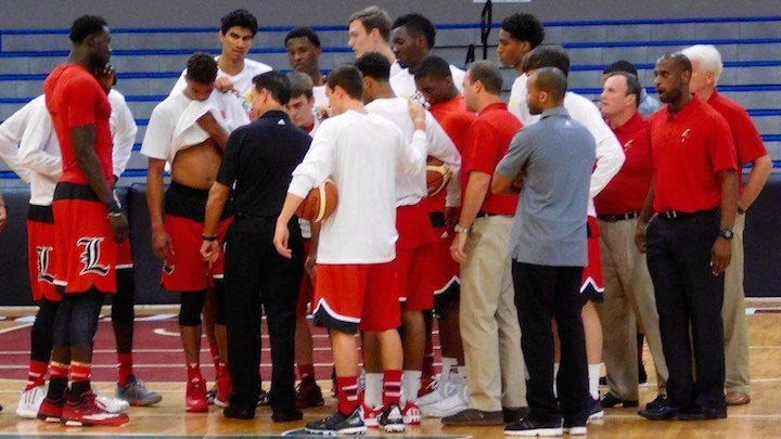 Rick Pitino talks to his team before a summer exhibition in Puerto Rico. The coach has devised an MVP scoring system for games and practices to incentivize things he wants to see on the court. (WDRB photo by Eric Crawford)