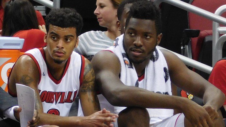 Quentin Snider, who matched a career-high with 8 assists, and Chinanu Onuaku, who matched a career high 18 points, watch in the closing moments in Wednesday's win over Kennesaw State. (WDRB photo by Eric Crawford)