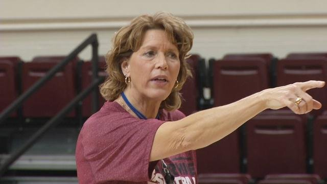 Chancellor Dugan instructs her team during a recent practice. (WDRB photo by Mike Lacett.)
