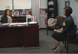 WDRB reporter Toni Konz visits with Waggener High principal Katy Zeitz in April 2015 (WDRB News)