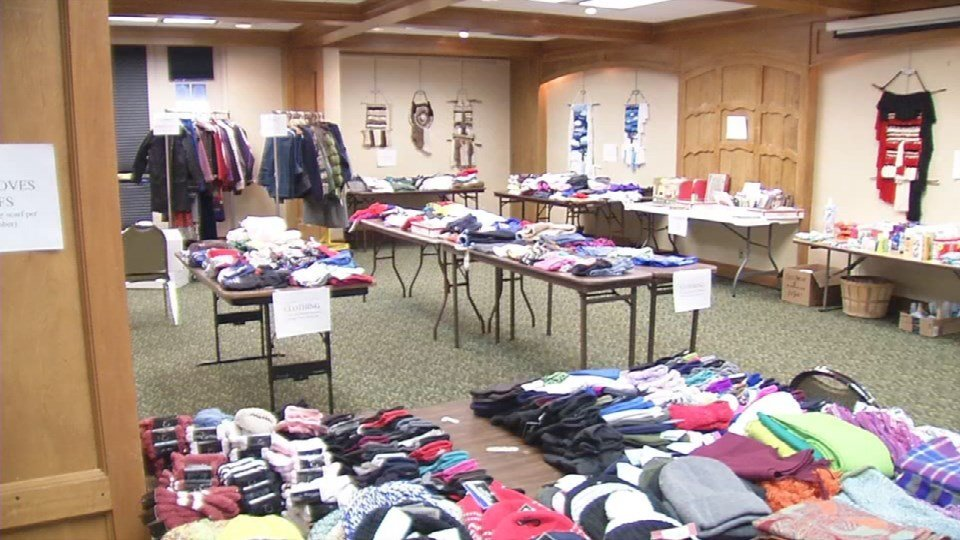Tables full of clothing inside Wayside Mission's Miracle on Broadway.