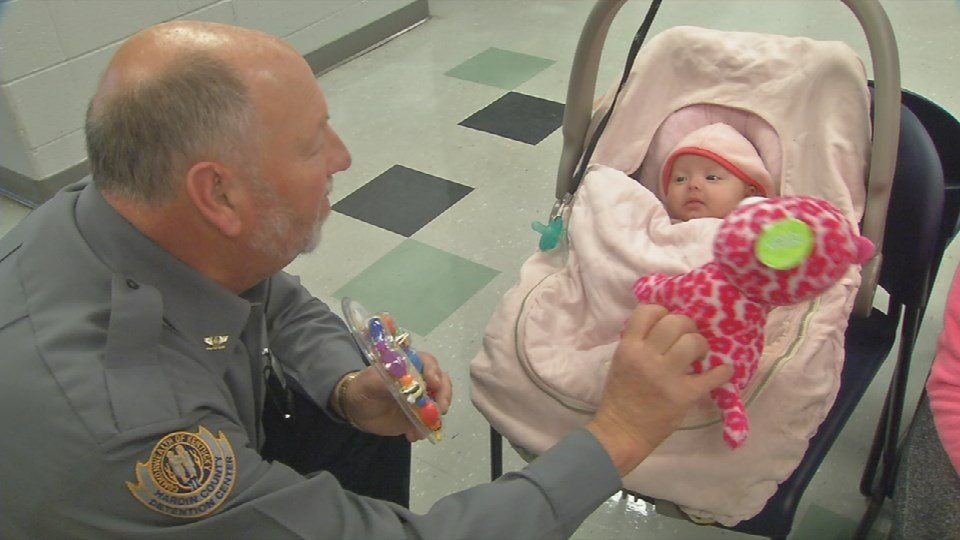 A little baby could not help but smile at Hardin County Jailer Danny Allen, who turned into a warm, fuzzy teddy bear around her -- talking in a baby voice and dancing a toy in her face.